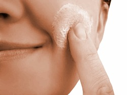 applying pimple cream